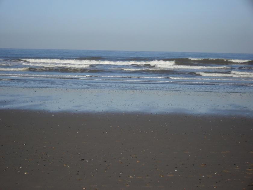 Waves crashing onto Holkham Beach
