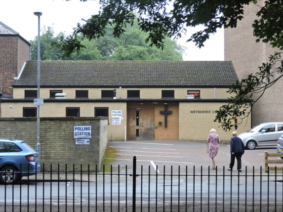 The polling station, with a couple of voters on their way in.