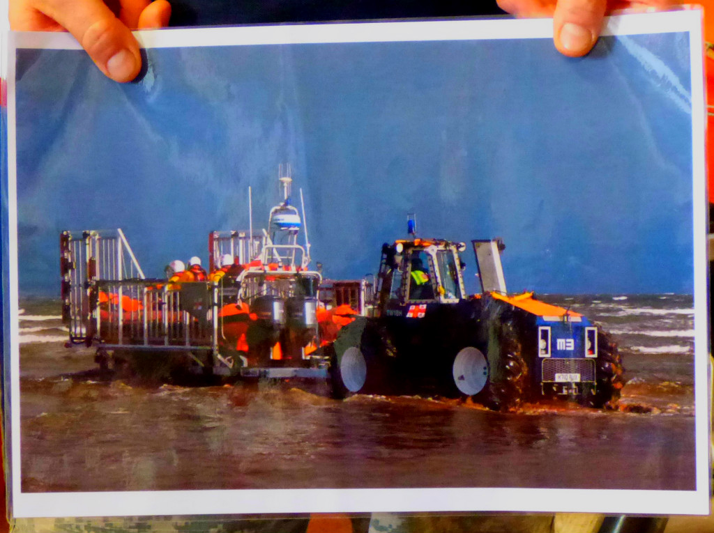 boat being pulled by tractor
