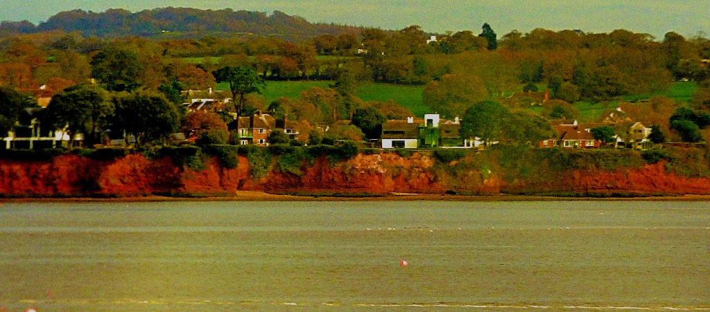 Red cliffs, buildings and trees