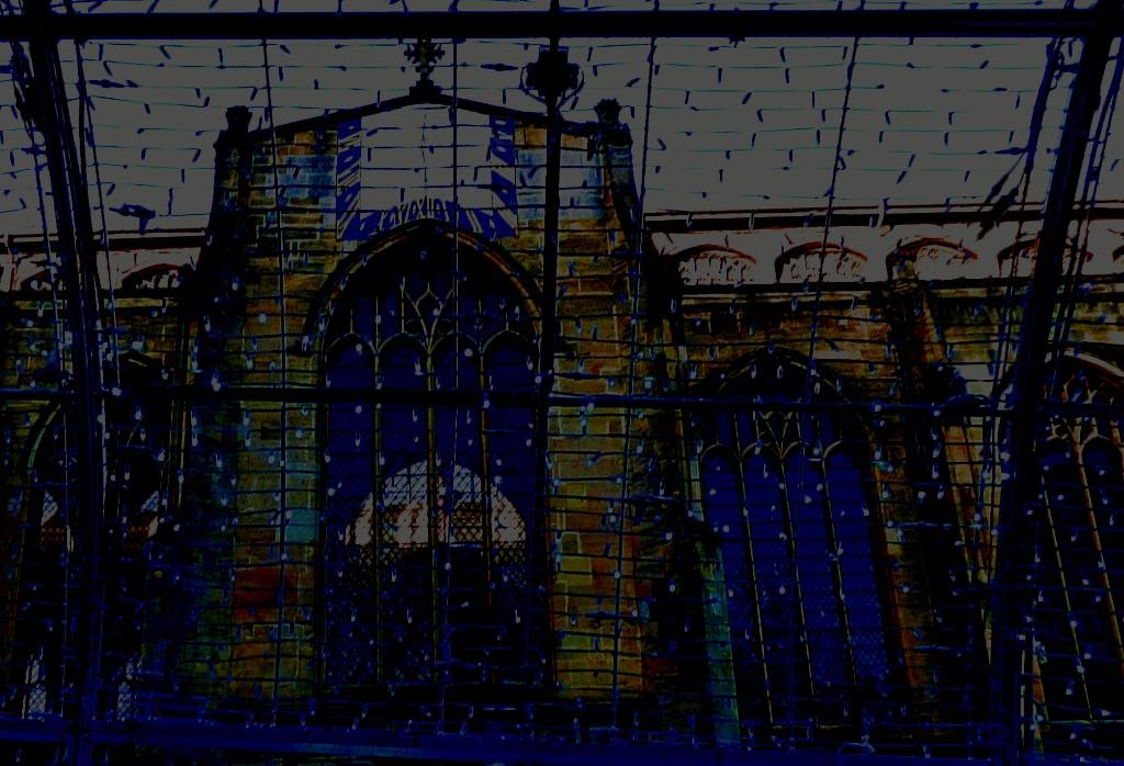 St Peter Mancroft clock through light curtain