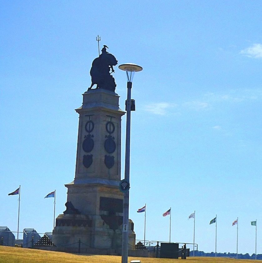 statue and flags