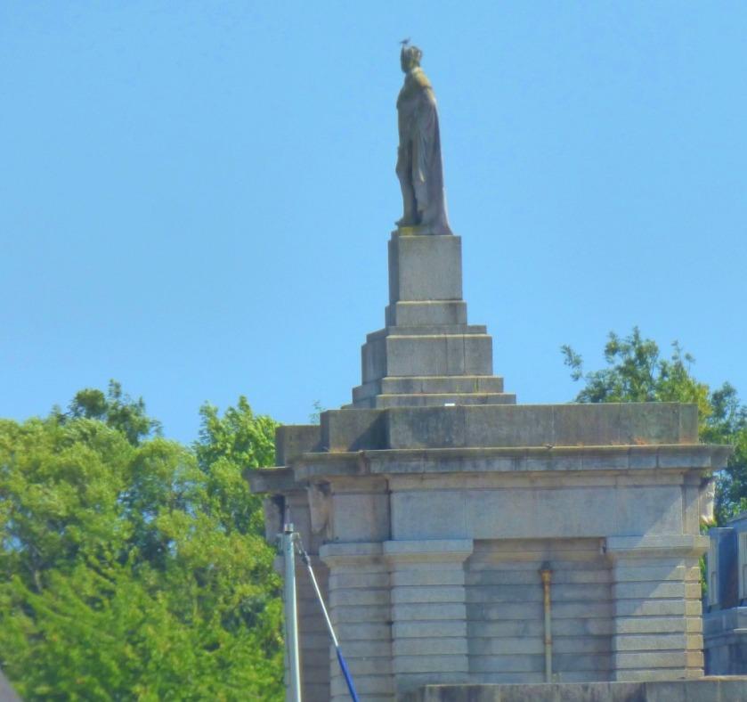 Statue atop building