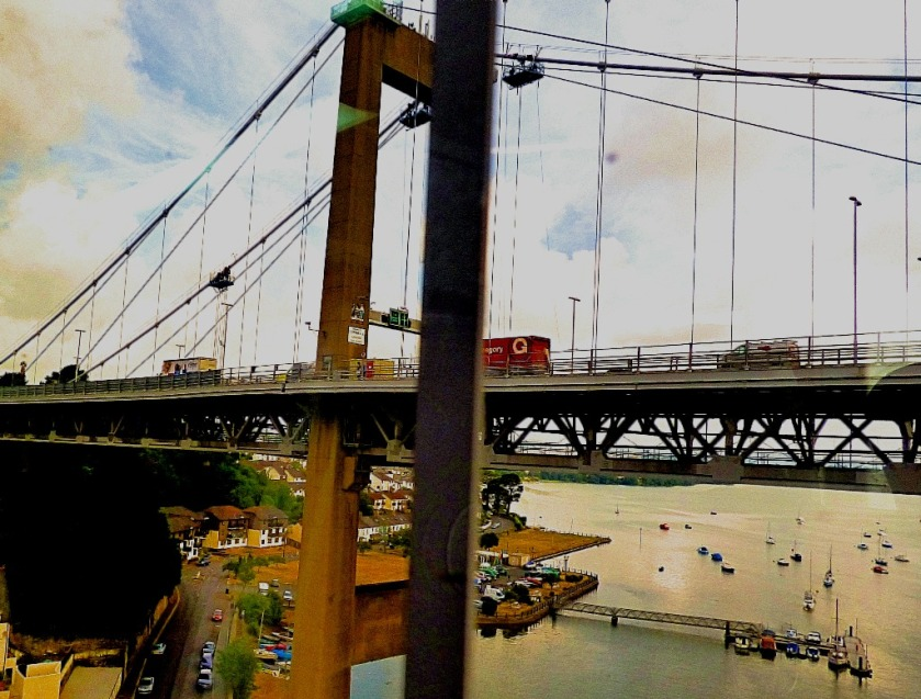 suspension bridge and boats