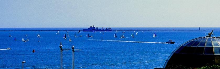 Yachts and a warship